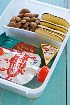 """Travel Snack Box for Kids:  Love this idea of packing a snack tray! Can be used for an """"in the car after school snack"""" on those days you never seem make it home after school. Or use the same idea for half day summer camps, school snack, or road trips!"""