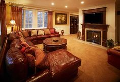 Forget the furnishings and decorating, but I want living room/dining room combo separated like this by a fireplace with the dining room lined with wall to wall bookshelves and easily accessible to the living room with comfy reading chairs and cushions.