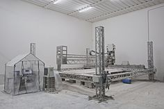 The D-Shape Gigantic 3D Printer: http://3dprintboard.com/showthread.php?2698-D-Shape-Large-3D-Printer