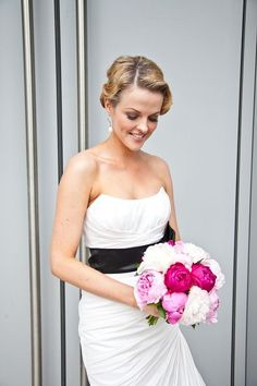 Black & White wedding dress, with a Pink flower bouquet.