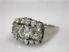 One 14 karat white gold cluster ring. One old European cut diamond, Two old mine cut diamonds, Ten old European cut diamonds