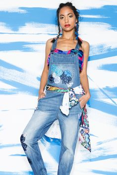 Check out this denim jumpsuit with embroidery flowers and worn jeans look styled with a foulard turned to top and some shirts used like belts. This mix and match style comes from ethnic to exotic through the look.