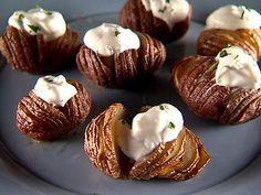 Garlic Hasselback Potatoes with Herbed Sour Cream - clever way to slice and season potatoes for a side dish