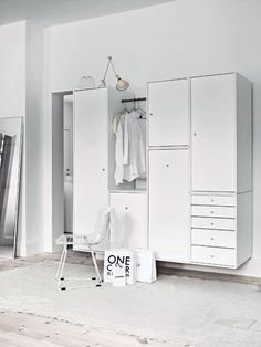 Floating open closet cabinet with various types of organization #white