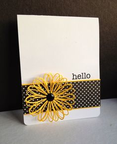 Beautiful die cut flower (Memory Box Tilth Flower) was cut 3 times and layered to make this real-looking yellow flower.  The flower is the star with a small piece of black and white dotted paper behind it and a mostly white front. Handmade hello card.