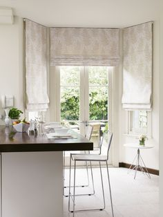 Our Almond Butter Roman blind is the perfect neutral fabric for a kitchen, living room or dining room. In fact, with an added blackout lining, it's perfect for a bedroom too. We've used ours to add softness to a bay window in our modern kitchen-diner.