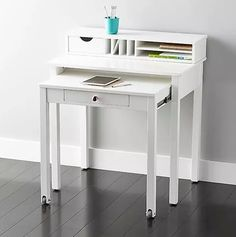 If you think you can't fit a workspace into your tiny apartment, think again. The diminutive proportions and clever designs of these 14 desks makes them perfect for small spaces. No matter how limited the space available, you're sure to find something here that's a perfect fit.