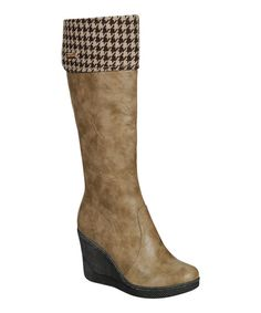 Be fashionably ready for cooler temps in this stylish boot, which features a fabric lining in a chic houndstooth print.3.75'' heel13.5'' shaft15'' circumferenceSide zipper closureMan-made upperCushioned footbed