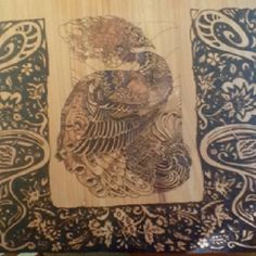 Peacock pyrography on cedar. The art of pyrography is better known as wood burning.