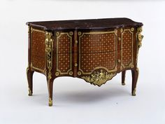 Commode - Place of origin: Paris, France, (made) Date:1774 (made), Artist/Maker:        Joubert, Gilles, born 1689 - died 1775 (probably, maker). Materials and Techniques: Marquetry of tulipwood, kingwood and other woods, on an oak carcase, with gilt-bronze mounts and a red griotte marble slab.