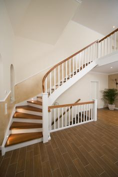 Closed staircase in the Merbau wood species with Krümmling in the spiral, white . Metal Barn Homes, Metal Building Homes, Pole Barn Homes, Building A House, House Stairs, Basement Stairs, Pole Barn House Plans, Staircase Remodel, Trophy Rooms