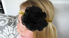 This adorable handcrafted baby headband features a beautiful chiffon flower in black. The flower measures approximately 3.5 in diameter and
