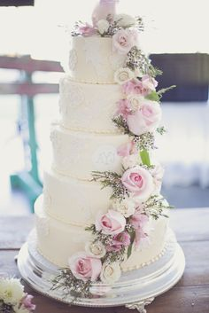 Large tiered wedding cake with floral details: http://www.stylemepretty.com/illinois-weddings/belleville/2014/06/24/rustic-meets-vintage-diy-wedding/ | Photography: Redeeming Love - http://www.redeeminglovephotography.com/