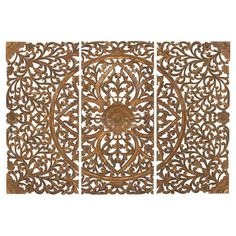 Add artful appeal to your entryway or home library with this scrolling wall decor, showcasing a gold finish and carved design.  Prod...