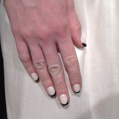 How cool is this white & black manicure at  #nyfw #weddingideas