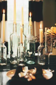 wine bottles (clear + painted gold) + tall candles (will last longer)