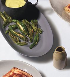 Padron Peppers Stuffed with Tetilla Cheese  The heat of this appetizer from Galicia, Spain, is tamed by Tetilla cheese, a creamy cow's-milk cheese from Galicia, and a garlicky mayonnaise that's inspired by Spanish allioli.    Read More http://www.bonappetit.com/ideas/party-appetizer-recipes/search?page=2&rows=10&query=keywords%3aparty-appetizer-recipes#ixzz1ZTTpdeuG