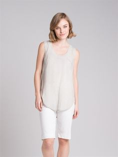 A+tank+style+top+with+a+flattering+scooped+hemline.+Feature+zip+detail+at+the+back+of+the+neck.+Looks+great+worn+under+jackets+and+knits+or+layered+with+a+sheer+chiffon+piece.  Composition:+100%+Viscose. Care:+Cool+gentle+hand+wash.+  Made+in+Australia.+#TheArkClothingCompany