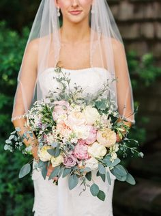 Large bouquet of assorted garden roses wrapped in a family heirloom