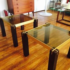 Pair of brass and rosewood end tables $400