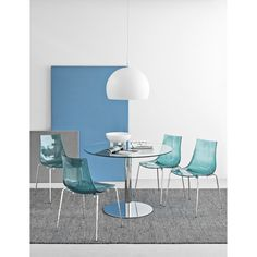 Led Side Chair with single-shell seat and backrest in SAN techno polymer. The wraparound, yet streamlined shape of the seat makes it pleasant and ergonomic to use. Stackable to save space.