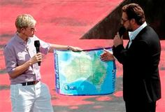 (AP Photo/Rick Rycroft). U.S. talk show host Ellen DeGeneres, left, has actor Russell Crowe show her a map of Australia during a recording of her show in Sydney, Australia, Saturday, March 23, 2013.
