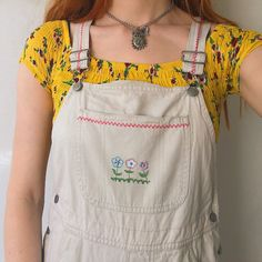 d36d17f5ae4 Cutest cream vintage short dungarees 💛 with adorable lil flowers  embroidered on the front and back. In a flattering shape