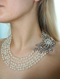 Multi-strand pearl necklace with side  rhinestone clasp