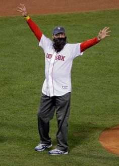 Carlton Fisk wears a beard as he throws out the ceremonial first pitch before Game 6 of the World Series