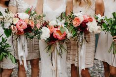 wedding bouquets | mix and match short neutral bridesmaid dresses | white cream coral burgundy and green bouquets with trailing ribbons | casual chic modern rustic tented wedding reception in the city | modern boho wedding