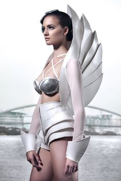 Armor on the female body is common in fashion depictions of the future. Representations of a shield to protect a woman from the attacks of the enemies. An independent woman of the future has the capability to be her own superheroin.