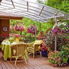 Pretty potplants and charming outdoor furniture brighten this outdoor area.