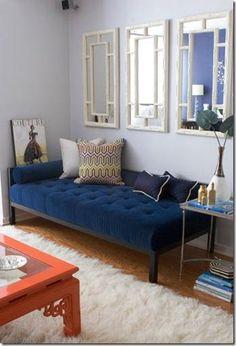 Gina Kates: Erinn V Design Group - White faux bamboo mirrors, blue tufted velvet settee bench, ...