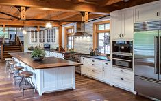 A smart open-concept timber frame kitchen layout features a balance between storage, function and style. Home Decor Kitchen, New Kitchen, Home Kitchens, Kitchen Layout Plans, Painted Brick Walls, Rustic Home Design, Timber Frame Homes, Timber Frames, Cuisines Design