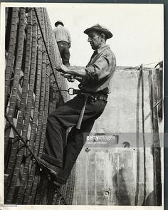 Steel worker at Grand Coulee Dam. His belt locked to the reinforcement bar, his hands are free for the wiring job under way. Five thousand, seven hundred thirty-nine men are employed at the dam site on the Columbia River, eastern Washington.