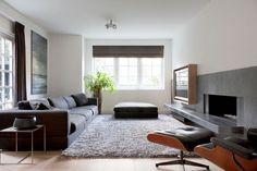© Remy Meijers mooie woonkamer  Zetel, tapijt, parket, gordijnen en openhaard. TV mooi weggewerkt!!!