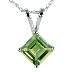 This pendant features a Peridot gemstone. Gemstone weighs Approximate Measurements: Pendant measures Pendant comes with an 18 inch rope chain also crafted in White Gold. Peridot Jewelry, Peridot Necklace, Gemstone Necklace, Pendant Necklace, My Birthstone, To My Daughter, Jewelry Watches, White Gold, Jewels
