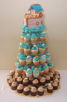 I love this Noah's Ark Cake & cupcake tower! ♡ One Stop Sweets in Massachusetts did a fantastic job. It looked great with the Noah's Ark baby shower centerpieces and they were delicious!  Animal cake. Baby shower cake. Under sea cupcakes.