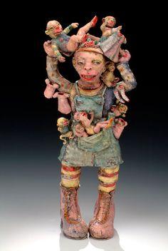 "Janis Mars Wunderlich, Laundry Monkeys, 2005. Hand-built earthenware, slips, underglaze and glaze, 18 x 8 x 6 in. An amusing view of everyday household chores, doing laundry, juggling children; inspired by folk art ""sock monkeys""."