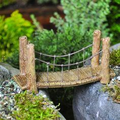 Suspension Bridge – eFairies.comSuspension Bridge is just what every fairy garden needs to help the fairies and gnomes cross those difficult paths whether it be a stream of water, or a ditch. A charming display of sturdiness the fairies can depend on crossing for safety. Dimensions: 2 1/8 H x 4 W x 1 1/2 D Material: Resin, wire 7.99