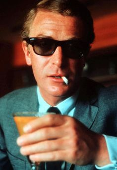 Michael Caine. You and I know Damn well that he is just cool enough to drink that without taking the cigarette out of his mouth.....