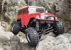 OMG i so need to get one of these for kurtis...both!   RC Toyota Land Cruiser FJ40 Rock Crawler