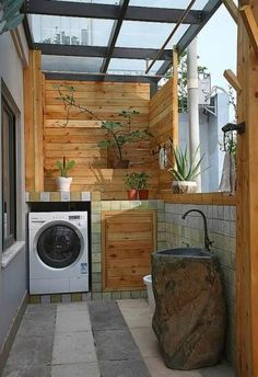 If you're using your balcony as your wash room there is no excuse in not decorating it. Add special pieces of potted plants that can help in air circulation and server as design as well. You can even customize your sink to blend in the wooden themed environment.
