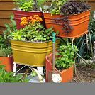 Upcycling old wash tubs and chimney flues - So much cuter than regular plastic planters...I just have to find some!