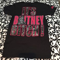 "Vintage Britney Spears tour t-shirt Vintage Britney Spears tour Tshirt. ""It's Britney bitch"" is the design on the back. It's a size small. Very little stretch to it. Would fit S or XS more loosely. 100% cotton but no shrinkage because it's only been worn a few times and I hang dry my clothes. Tops Tees - Short Sleeve"