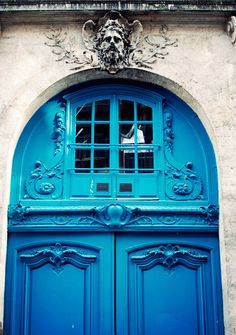 The Le Marais district of Paris spreads across parts of the 3rd and 4th arrondissements. This area is unique because it was favored by French nobility hundreds of years ago and many of their 'urban mansions' were tucked away behind large sets of doors all over the area.  nubby twiglet