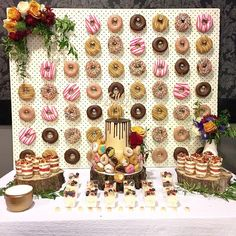 Simple pegboard donut wall with Krispy Kreme donuts makes a colorful and tasty backdrop for the dessert table