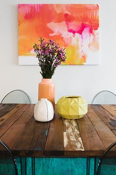 Darlinghurst Apartment - Emma Blomfield Interior Stylist Sydney. Dining Room. Raw Timber Table. Ghost Chairs. Watercolour Art. Table Styling. Flowers and Vases.