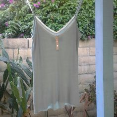 """FINAL SALE, THEN DONATING Cute Cami - NWOT Cami with functioning buttons, lace trim, and adjustable straps. 63% rayon, 35% cotton, 2% spandex. Very pretty bluish/gray color. New condition, never worn. The measurement of the top to hem is about 21.5"""" long (not including straps). No trades, holds, or Paypal. Pamela Stewart Tops Camisoles"""