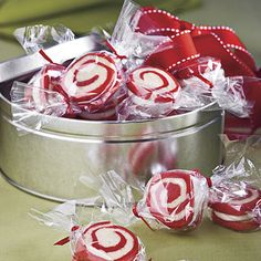 Peppermint Pinwheel Cookies Fill inexpensive metal containers from crafts stores with Peppermint Pinwheel Cookies for a gift your neighbors and friends will love. Recipe at http://www.myrecipes.com/recipe/peppermint-pinwheel-cookies-10000001860238/